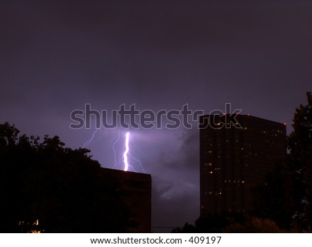 Lightning Strike Behind Buildings in Houston, TX - stock photo