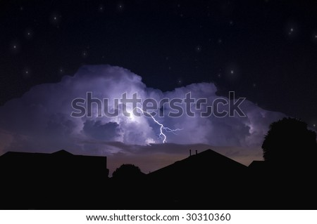 Lightning strike in a dark local neighborhood during a power outage and star field background - stock photo