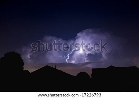 Lightning strike in a local neighborhood during a power outage - stock photo