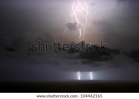 Lightning Strike into the Ocean - stock photo