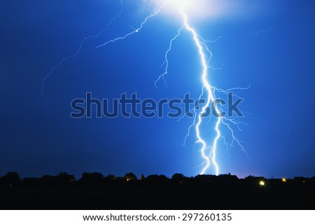 Lightning strike on a stormy night - stock photo