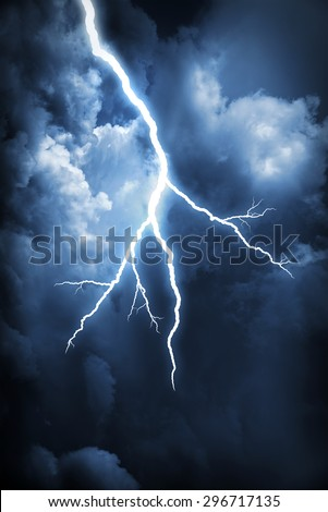 Lightning strike on the cloudy dark sky - stock photo