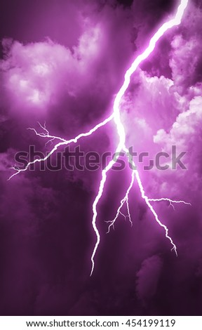 Lightning strike on the cloudy dark sky. - stock photo