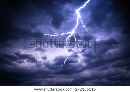 Lightning strike on the dark cloudy sky - stock photo