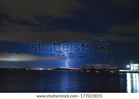 Lightning strike over punta gorda in south west florida after dark - stock photo