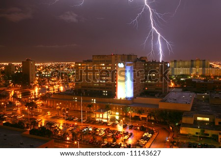 Lightning strikes a building in Miami FL during hurricane storm - stock photo