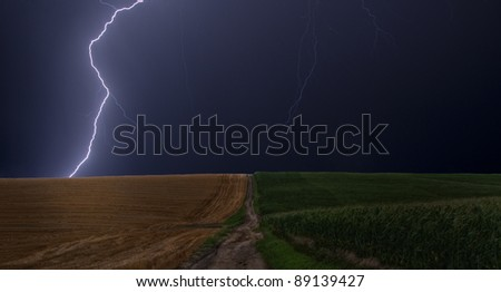 Lightning strikes between a field of wheat and corn