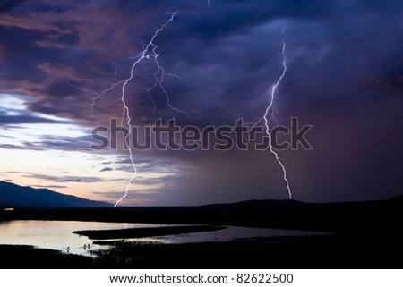 Lightning Strikes over a scenic Montana background - stock photo