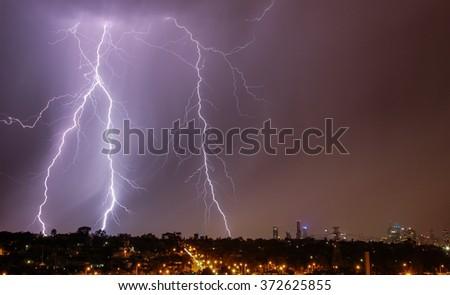Lightning strikes over Melbourne city skyline - stock photo