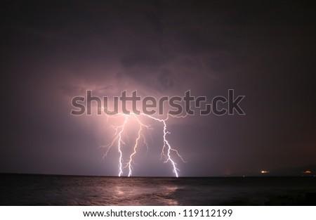 Lightning Strikes Severe Lightning At Open Sea - stock photo
