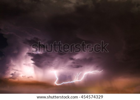 Lightning with dramatic clouds in thailand.Image is dark tone. - stock photo