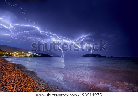 Lightnings and rain over Budva coastline in Montenegro. - stock photo