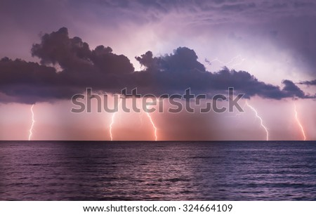 lightnings in dark sky, stormy sea