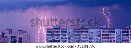 Lightnings in the sky - evening rainy city landscape - stock photo