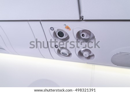 lights, air condition signs panel above the seat on plane