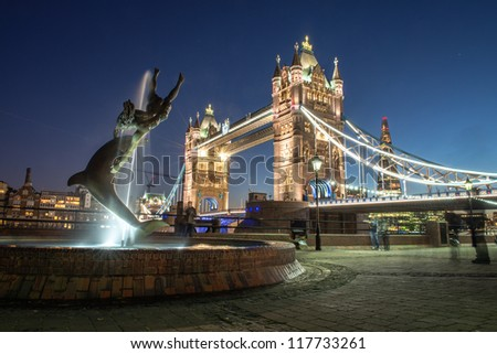 Lights and Colors of Tower Bridge from St Katharine Docks at Night - London - UK - stock photo