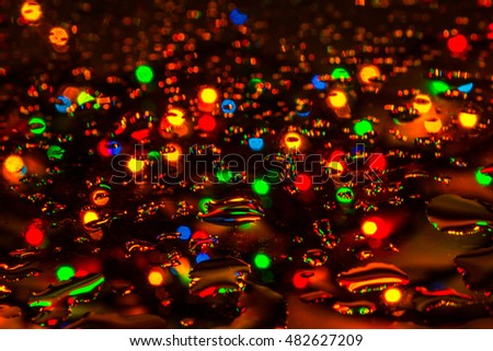 Lights and drops of water. Background.