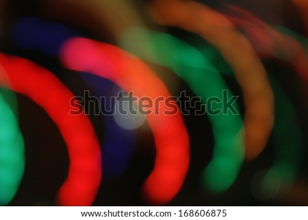 Lights blur motion in semicircles on black - stock photo
