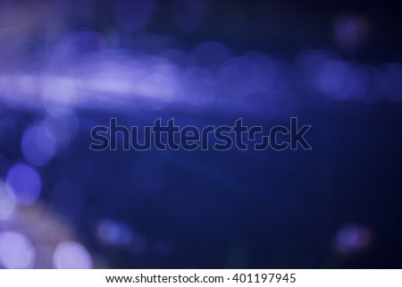 Lights bokeh on blue background. raw material for background. - stock photo