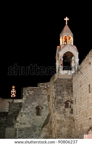 Lights decorate steeples of the Church of the Nativity, traditional site of the birthplace of Jesus Christ, in the West Bank town of Bethlehem. - stock photo