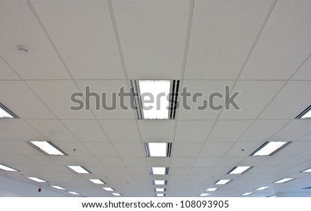 Lights from ceiling of business office building - stock photo