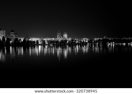Lights night city with reflections on the river black and white - stock photo