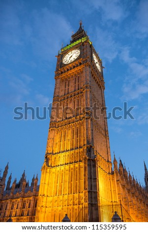Lights of Big Ben at Dusk with blurred moving cloud - London - UK - stock photo