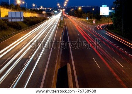 Lights on Cars in Motion on Night Highway - stock photo