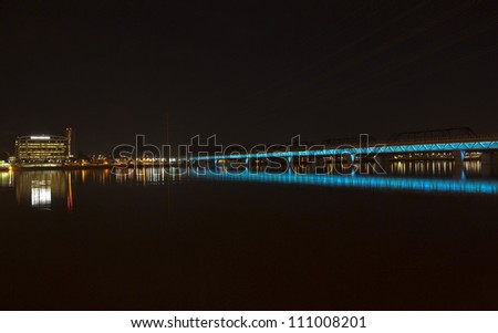 Lights on the light rail bridge light up Tempe Town Lake - stock photo