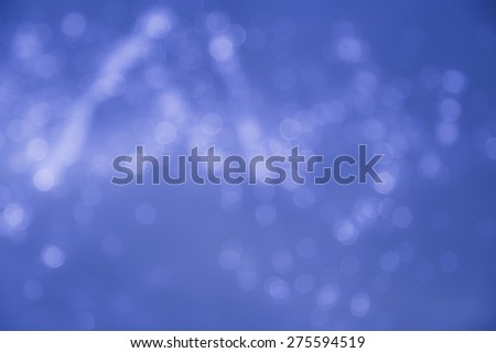 Lights on water blue bokeh background - stock photo