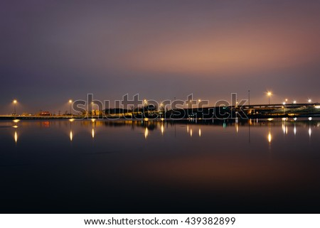 Lights reflecting in the Potomac River at night, seen from National Harbor, Maryland. - stock photo