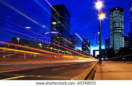 lights trails from cars in business center - stock photo