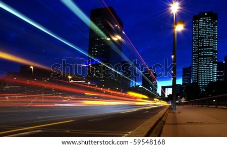 lights trails of cars in building center - stock photo