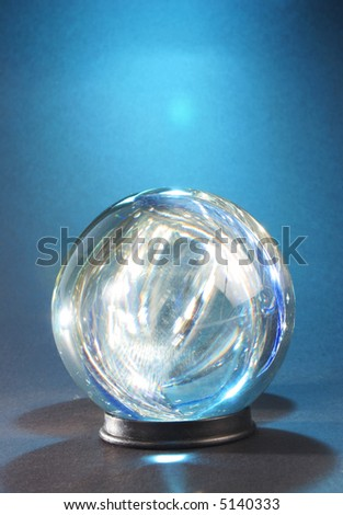 lights within crystal ball against blue - stock photo