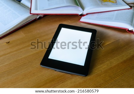lightweight e-book (electronic reader) compared to heavy thick books - stock photo - stock photo