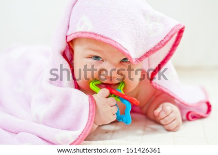 liitle baby with her toy - stock photo