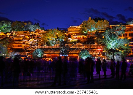 LIJIANG, CHINA - NOVEMBER 28, 2014: Old Town of Lijiang has a history going back to the thirteenth century and was a confluence for trade along the old tea horse road.It located 2400 meters high. - stock photo