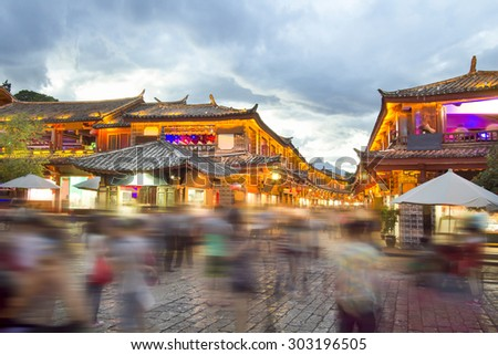 Lijiang old town in the evening with crowed tourist , Yunnan China. - stock photo