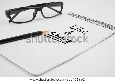 Like and share is written on notepad