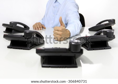 like hand with office phones on desk