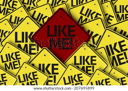 Like Me! written on multiple road sign - stock photo