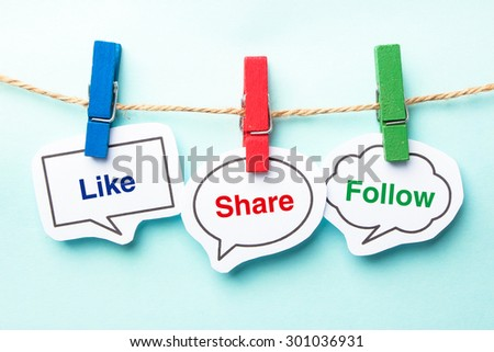 Like share follow bubble with clip hanging on the line with blue background. - stock photo