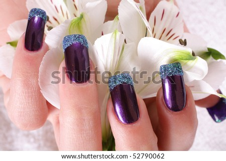 Lila manicure hand - stock photo