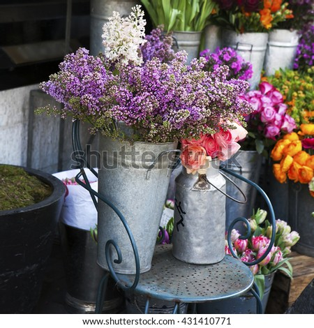 Lilac and peony bouquet on the iron chair - stock photo