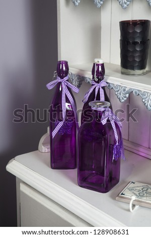 lilac bottle An antiques stall, at a Country Fair, but could be Antiques or Flea Market. - stock photo