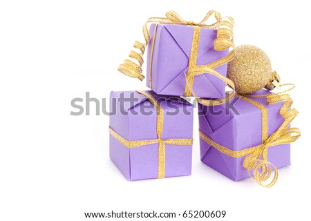 lilac boxes with golden ribbon isolated on white background