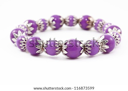 Lilac bracelet on white - stock photo