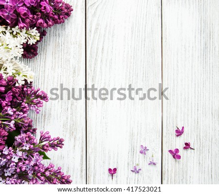 Lilac flowers on a old wooden background - stock photo