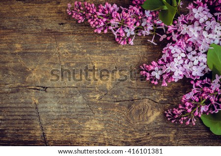 Lilac horizontal background. Twig purple lilac on wooden board with place for text. Syringa vulgaris. Spring flower. Happy Mothers Day. Mother's Day greetings card. Mothers Day gift.  - stock photo