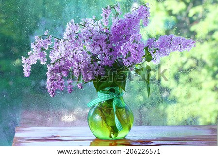 lilac in a vase on the window - stock photo